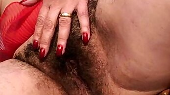 Bosomy blond haired sweetie has her hairy vagina attacked