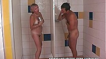 Blonde slut sucks two dicks in the shower