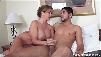 Busty milf jerking a young red dick